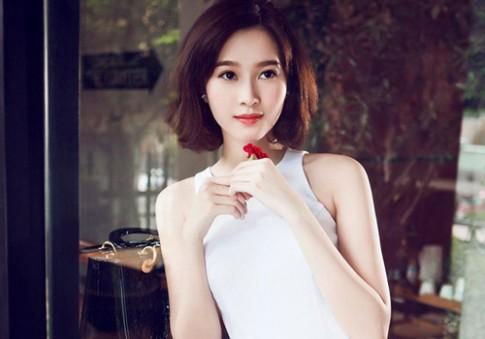 Phong cach trang diem dep rang ngoi cua hoa hau Dang Thu Thao