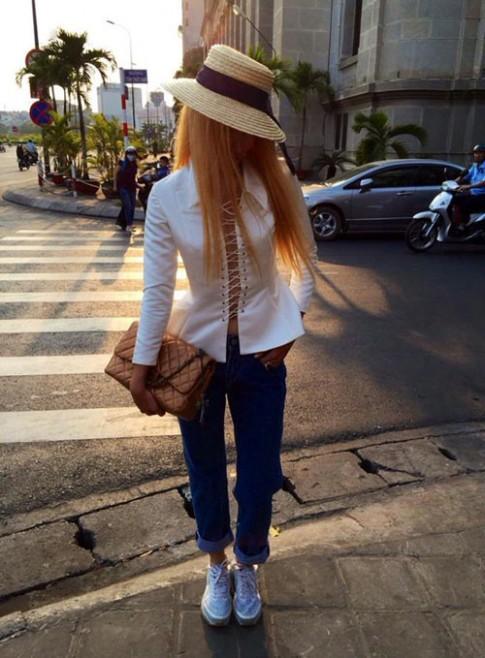 Tuan qua: Huyen Trang noi loan voi toc vang hoe