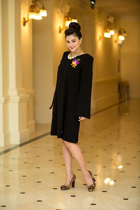 Vu Thu Phuong kheo leo che bung bau di sụ kiẹn