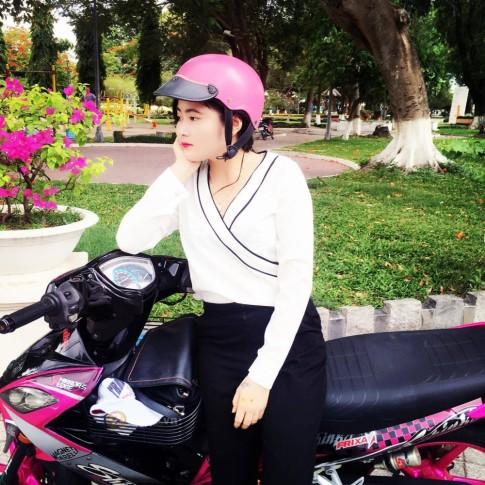 Chiec Exciter 135 do Hong ca tinh cua Nu Biker Tay Ninh