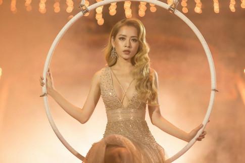 Chi Pu xinh nhu Hoa hau trong MV moi, khong kem canh Minh Tu khi dung vay