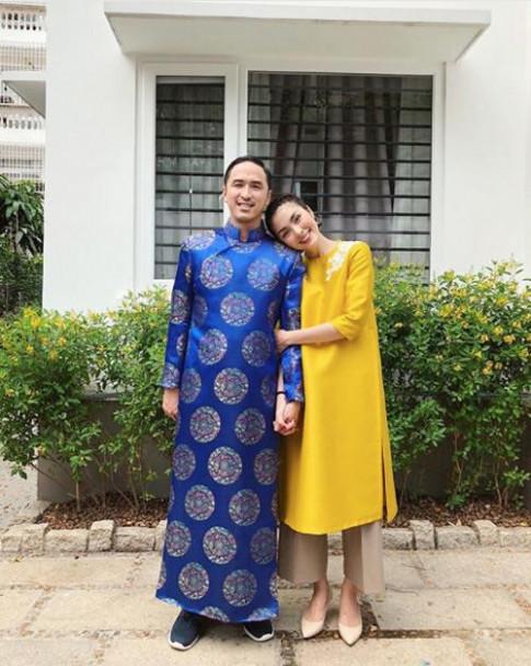 Vo chong Tang Thanh Ha dien ao dai, nam chat tay nhau hanh phuc trong ngay Tet